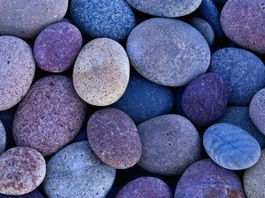 Round beach rocks in shade - photography by Brent VanFossen.