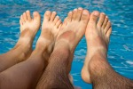 feet suntanned over water