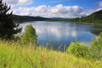 landscape scenic of grass and lake in mountains