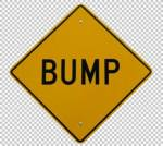 sign bump in road