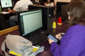 Students using tablet in classroom to track homework